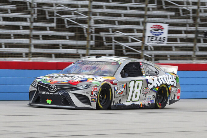 Kyle Busch drives on the front stretch during a NASCAR Cup Series auto race at Texas Motor Speedway in Fort Worth, Texas, Wednesday, Oct. 28, 2020. (AP Photo/Richard W. Rodriguez)