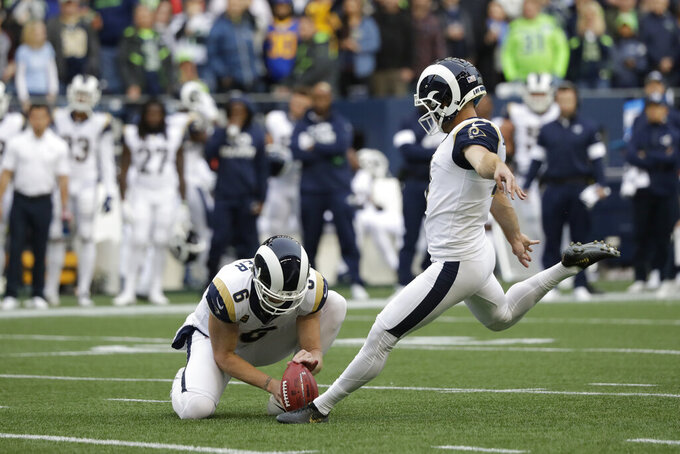 With Johnny Hekker holding, Los Angeles Rams' Greg Zuerlein kicks a field goal during the first half of the team's NFL football game against the Seattle Seahawks, Thursday, Oct. 3, 2019, in Seattle. (AP Photo/Elaine Thompson)