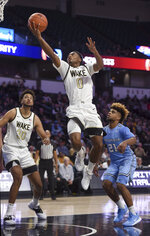 Wake Forest's Brandon Childress (0) goes for a layup against Columbia in the first half of an NCAA college basketball game, Sunday, Nov. 10, 2019, in Winston-Salem, N.C. (Walt Unks/Winston-Salem Journal via AP)