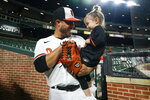 Baltimore Orioles relief pitcher Manny Barreda talks to his daughter, Sofia, 2, after he recorded the win during his professional debut in a baseball game against the Kansas City Royals, Wednesday, Sept. 8, 2021, in Baltimore. The Orioles won 9-8. (AP Photo/Julio Cortez)