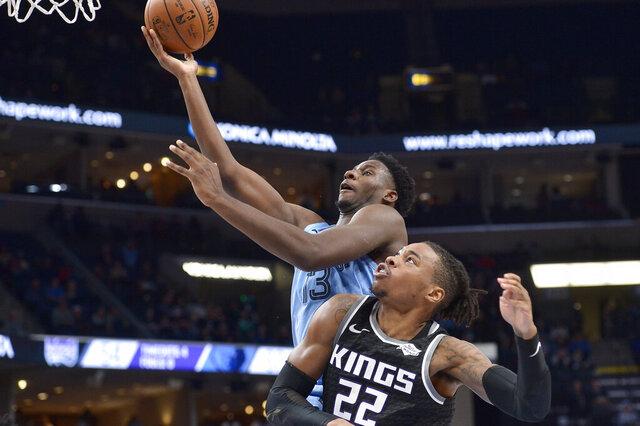 Memphis Grizzlies forward Jaren Jackson Jr. shoots against Sacramento Kings forward Richaun Holmes (22) in the second half of an NBA basketball game Saturday, Dec. 21, 2019, in Memphis, Tenn. (AP Photo/Brandon Dill)