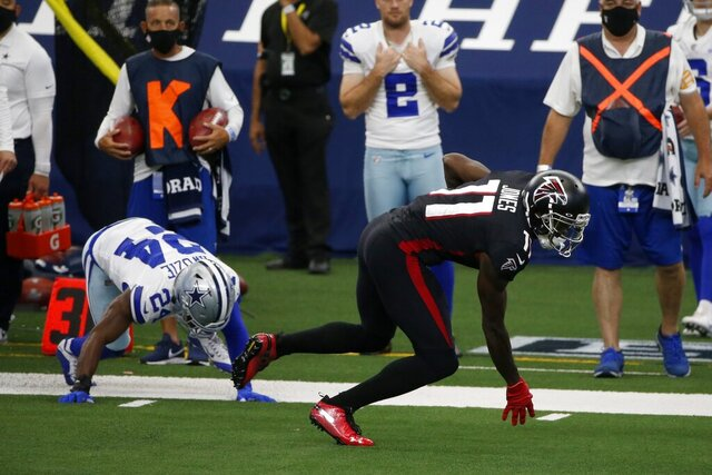 Atlanta Falcons wide receiver Julio Jones (11) makes a catch in front of Dallas Cowboys' Chidobe Awuzie (24) in the second half of an NFL football game in Arlington, Texas, Sunday, Sept. 20, 2020. (AP Photo/Michael Ainsworth)