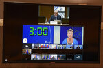 """Slovenian Interior Minister Ales Hojs, top of screen, speaks with European Commissioner for Home Affairs Ylva Johansson, middle of screen, as they participate in an emergency ministerial meeting via video link at the European Council building in Brussels, Wednesday, Aug. 18, 2021. European Union ministers are holding emergency talks Wednesday in response to allegations that Belarus is deliberately sending migrants to Lithuania as part of a """"hybrid warfare"""" campaign to destabilize the Baltic EU member country. (John Thys, Pool Photo via AP)"""