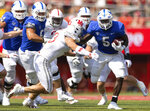 Buffalo's Kevin Marks (5) carries the ball against Nebraska's JoJo Domann (13) during the first half of an NCAA college football game, Saturday, Sept. 11, 2021, at Memorial Stadium in Lincoln, Neb. (AP Photo/Rebecca S. Gratz)