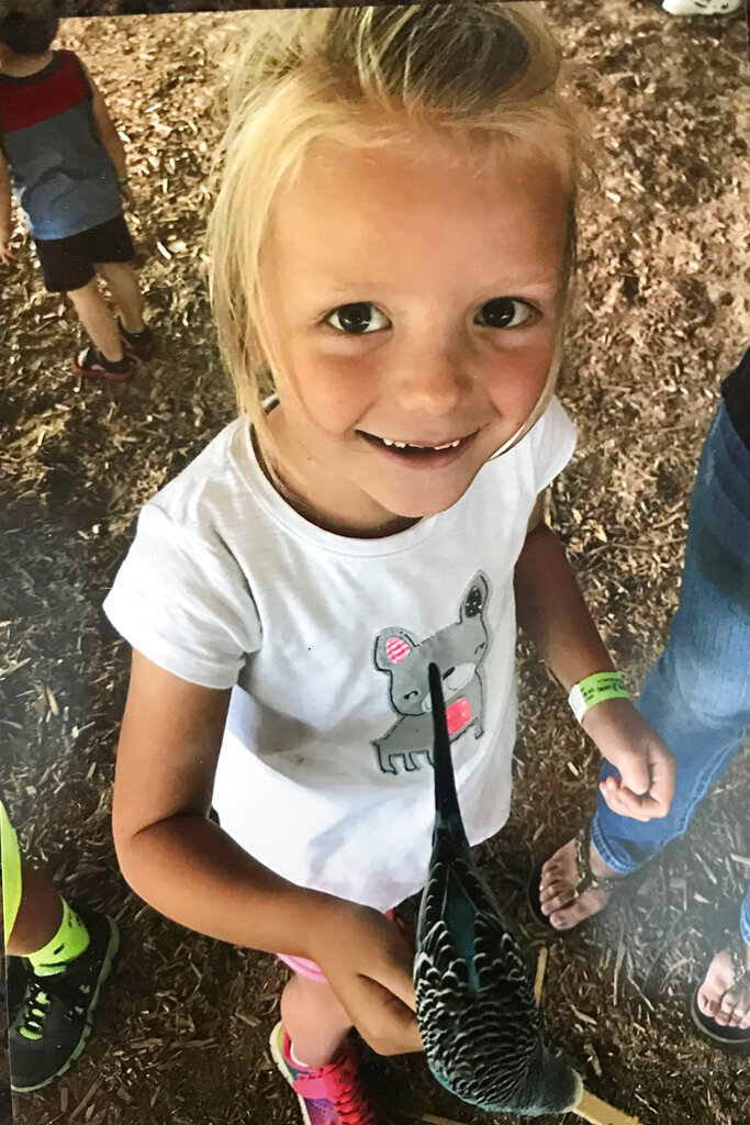 This undated handout photo provided by Geoffrey Mertens shows Emma Mertens at Timbavati Wildlife Park in Wisconsin Dells, Wis. The Wisconsin girl with an inoperable brain tumor who received tens of thousands of pictures of her favorite animal from strangers has died at age 8. Her family says Emma died Sunday, Nov. 17, 2019. (Courtesy of Geoffrey Mertens via AP)