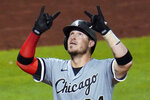Chicago White Sox's Yasmani Grandal celebrates as he crosses home plate after hitting a two-run home run off Pittsburgh Pirates relief pitcher Dovydas Neverauskas during the fifth inning of a baseball game in Pittsburgh, Tuesday, Sept. 8, 2020. (AP Photo/Gene J. Puskar)