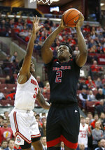 Rutgers center Shaquille Doorson, right, goes up for a shot against Ohio State guard C.J. Jackson during the first half of an NCAA college basketball game in Columbus, Ohio, Saturday, Feb. 2, 2019. (AP Photo/Paul Vernon)