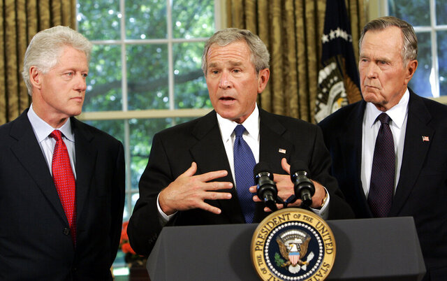 FILE - In this Sept. 1, 2005, file photo President Bush meets with former President George H.W. Bush, right, and former President Bill Clinton, right, in the Oval Office of the White House. In times of crisis, American presidents often turn to their predecessors for counsel. (AP Photo/Susan Walsh, File)