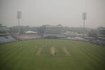Members of Indian cricket team practice at Arun Jaitely Stadium covered in smog ahead of their first T20 cricket match in New Delhi, India, Friday, Nov. 1, 2019. An expert panel in India's capital has declared a health emergency due to air pollution choking the city, with authorities ordering schools closed until Nov. 5. (AP Photo/Altaf Qadri)