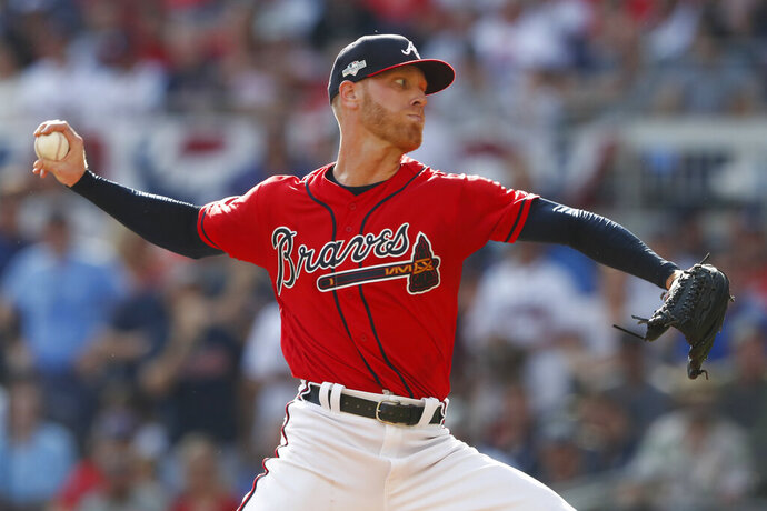 Atlanta Braves starting pitcher Mike Foltynewicz (26) works in the first inning during Game 2 of a best-of-five National League Division Series against the St. Louis Cardinals, Friday, Oct. 4, 2019, in Atlanta. (AP Photo/John Bazemore)
