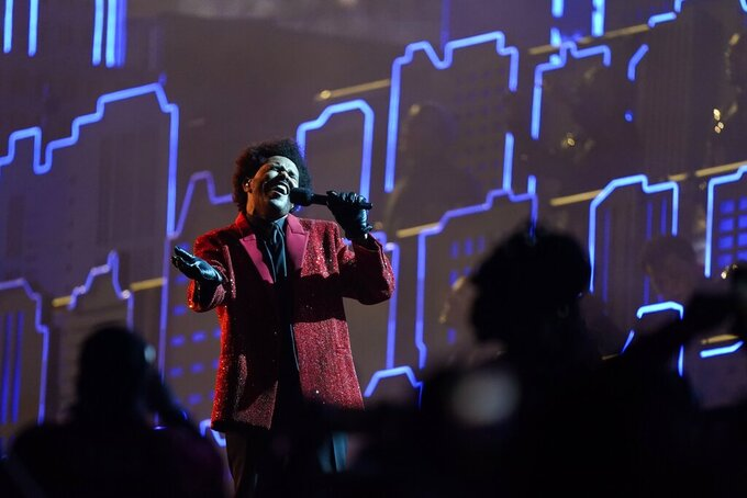 The Weeknd performs during the halftime show of the NFL Super Bowl 55 football game between the Kansas City Chiefs and Tampa Bay Buccaneers, Sunday, Feb. 7, 2021, in Tampa, Fla. (AP Photo/Mark Humphrey)