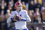 Florida quarterback Kyle Trask drops back to pass during the first half of an NCAA college football game against Missouri, Saturday, Nov. 16, 2019, in Columbia, Mo. (AP Photo/Jeff Roberson)