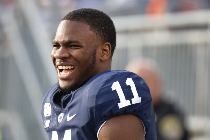 FILE - In this Aug. 31, 2019, file photo, Penn State linebacker Micah Parsons (11) laughs on the bench in the fourth quarter of an NCAA college football game against Idaho in State College, Pa. Parsons was selected to The Associated Press preseason All-America first-team, Tuesday, Aug. 25, 2020. Parsons and Oregon tackle Penei Sewell are among 11 players selected who are not slated to play this fall. (AP Photo/Barry Reeger, File)