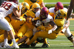 Iowa State running back Jirehl Brock (21) is brought down by Baylor players after a run during the first half of an NCAA college football game, Saturday, Sept. 25, 2021, in Waco, Texas. (AP Photo/Jim Cowsert)