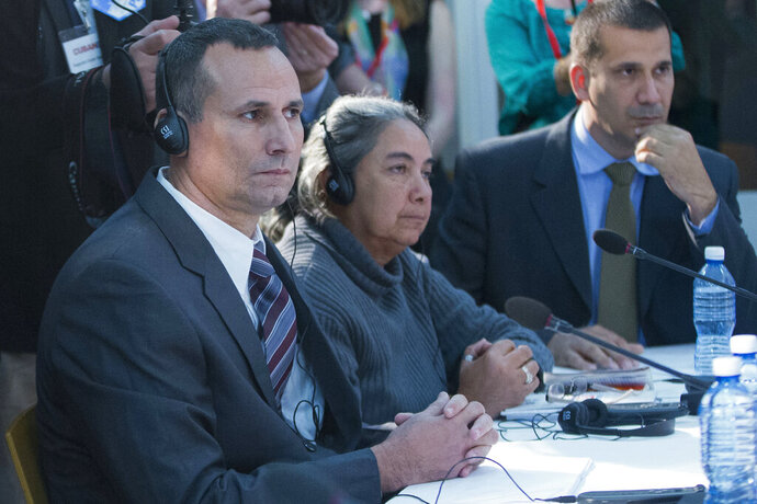FILE - In this March 22, 2016 file photo, Jose Daniel Ferrer, from left, Juana Mora Cedeno, and Antonio Rodiles, listen during their meeting with President Barack Obama at the U.S. Embassy, in Havana, Cuba. On Wednesday, Nov. 20, 2019 accused the top U.S. diplomat in the country of working closely with Ferrer, the detained head of one of the country's largest opposition groups.  The accusations against charge d'affaires Mara Tekach were a break from Cuba's normal language on U.S. relations, which had remained measured despite an escalating Trump administration campaign to cut off revenue and oil to Cuba. (AP Photo/Pablo Martinez Monsivais, File)