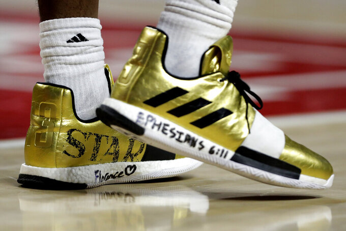 Messages are seen on the shoes of George Mason forward AJ Wilson during the first half of the team's NCAA college basketball game against Maryland, Friday, Nov. 22, 2019, in College Park, Md. Maryland won 86-63. (AP Photo/Julio Cortez)