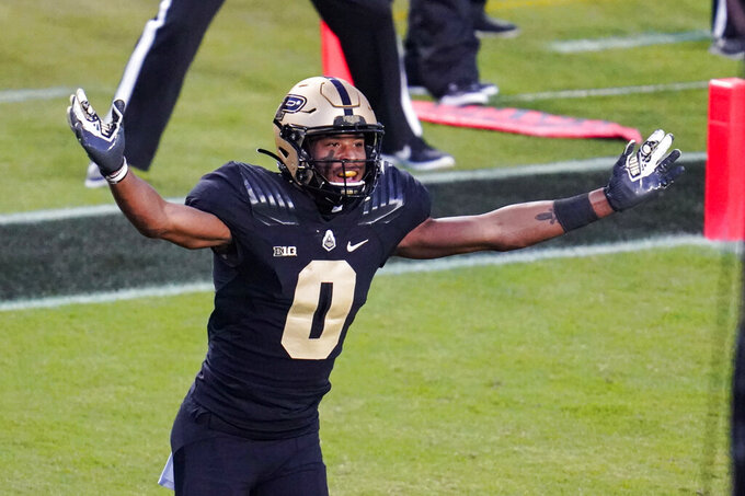 Purdue wide receiver Milton Wright (0) celebrates a touchdown by Purdue wide receiver David Bell (3) during the fourth quarter of an NCAA college football game against Iowa in West Lafayette, Ind., Saturday, Oct. 24, 2020. Purdue defeated Iowa 24-20. (AP Photo/Michael Conroy)