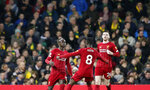 Liverpool's Sadio Mane, left, celebrates with teammates after scoring his side's opening goal during the English Premier League soccer match between Norwich City and Liverpool at Carrow Road Stadium in Norwich, England, Saturday, Feb. 15, 2020. (AP Photo/Frank Augstein)