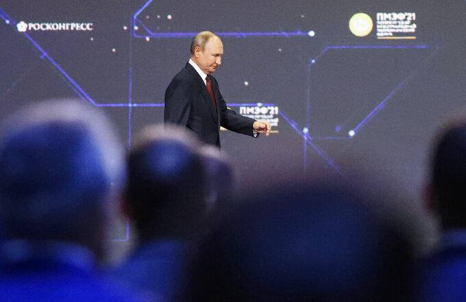 Russian President Vladimir Putin enters the hall during the St. Petersburg International Economic Forum in St. Petersburg, Russia, Friday, June 4, 2021. (Anatoly Maltsev/Pool Photo via AP)
