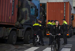 Police and army trucks block the roads leading to parliament during a farmers demonstration in The Hague, Netherlands, Wednesday, Feb. 19, 2020. Dutch farmers, some driving tractors, poured into The Hague on Wednesday to protest government moves to rein in carbon and nitrogen emissions to better fight climate change. (AP Photo/Peter Dejong)