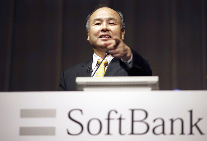 FILE - In this Nov. 4, 2014, file photo, SoftBank founder and Chief Executive Officer Masayoshi Son speaks during a news conference in Tokyo. Japanese technology giant SoftBank has committed billions of dollars to bailing out office space sharing startup WeWork. (AP Photo/Eugene Hoshiko, File)