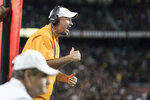 Tennessee head coach Jeremy Pruitt communicates with players during the first half of an NCAA college football game against South Carolina, Saturday, Oct. 27, 2018, in Columbia, S.C. (AP Photo/Sean Rayford)