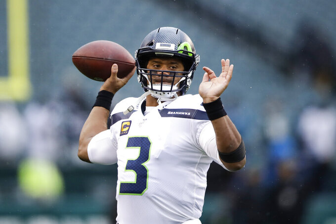 Seattle Seahawks' Russell Wilson warms up before an NFL football game against the Philadelphia Eagles, Sunday, Nov. 24, 2019, in Philadelphia. (AP Photo/Matt Rourke)