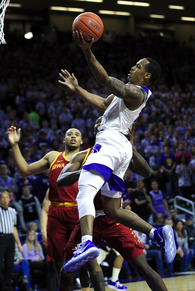 FILE - In this Feb. 16, 2019, file photo, Kansas State guard Barry Brown Jr. (5) goes to the basket during the second half of an NCAA college basketball game against Iowa State, in Manhattan, Kan. Brown was named to the AP All-Big 12 Conference team, Tuesday, March 12, 2019. (AP Photo/Orlin Wagner, File)