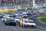 NASCAR Cup Series driver Denny Hamlin, right, leads drivers on a restart after a caution during a NASCAR Cup Series auto race at the Las Vegas Motor Speedway, Sunday, Sept. 26, 2021, in Las Vegas. Hamlin went on to win the race. (AP Photo/Steve Marcus)