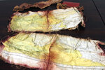 A map recovered from the 1952 crash of a C-124 Globemaster was found this month on Colony Glacier and displayed at Joint Base Elmendorf-Richardson, Alaska, Tuesday, Sept. 29, 2021. The plane slammed into a mountain, killing 52 on board, and the plane and its crew have since become part of the glacier. The military has conducted annual summer recovery efforts, finding human remains and personal items on the glacier. (AP Photo/Mark Thiessen)