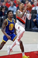 Portland Trail Blazers guard Damian Lillard, right, shoots past Golden State Warriors forward Jordan Bell during the first half of Game 4 of the NBA basketball playoffs Western Conference finals Monday, May 20, 2019, in Portland, Ore. (AP Photo/Craig Mitchelldyer)