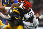 Cincinnati Bengals middle linebacker Preston Brown (52) tackles Los Angeles Rams running back Darrell Henderson during the second half of an NFL football game, Sunday, Oct. 27, 2019, at Wembley Stadium in London. (AP Photo/Frank Augstein)