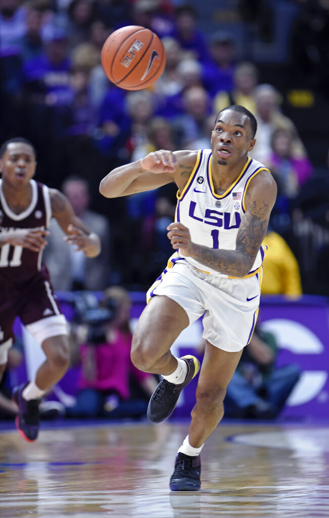 LSU guard Ja'vonte Smart (1) chases after the ball he just knocked loose as Texas A&M guard Wendell Mitchell (11) gives chase in the first half of an NCAA college basketball game, Tuesday, Feb. 26, 2019, in Baton Rouge, La. (AP Photo/Bill Feig)