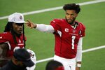 Arizona Cardinals' Kyler Murray (1) waves to fans in the stands in the first half of an NFL football game against the Dallas Cowboys in Arlington, Texas, Monday, Oct. 19, 2020. (AP Photo/Michael Ainsworth)