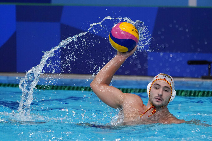 Spain's Alberto Munarriz Egana plays against Croatia during a preliminary round men's water polo match at the 2020 Summer Olympics, Monday, Aug. 2, 2021, in Tokyo, Japan. (AP Photo/Mark Humphrey)