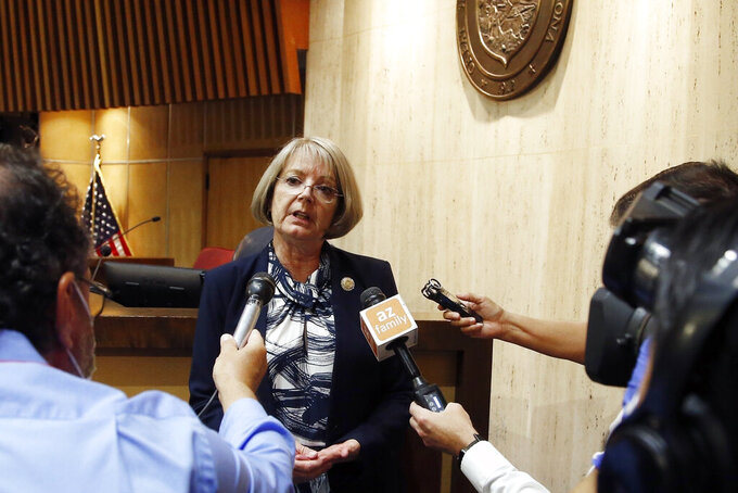 FILE - In this May 26, 2020, file photo, Arizona Senate President Karen Fann, R-Prescott, speaks to the media in Phoenix. A budget deal struck between Republican leader Fann and Rep. Rusty Bowers, R-Mesa, and Gov. Doug Ducey includes implementing a flat 2.5% income tax that cuts $1.5 billion a year from state revenue and keeps higher earning taxpayers from having to directly pay a new 3.5% surcharge to fund schools. (AP Photo/Ross D. Franklin, File)