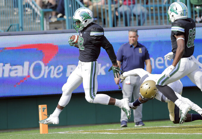 Tulane wide receiver Jabril Clewis (88) scores a touchdown against the Navy during an NCAA college football game at Yulman Stadium in New Orleans, Saturday, Nov. 24, 2018. (David Grunfeld/The Times-Picayune via AP)