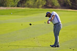 John Rahm hits from the ninth fairway during the first round of the Zozo Championship golf tournament Thursday, Oct. 22, 2020, in Thousand Oaks, Calif. (AP Photo/Marcio Jose Sanchez)