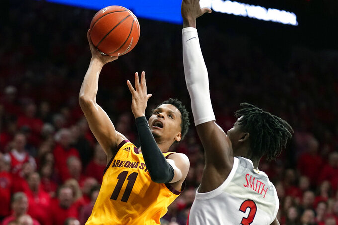 Arizona State guard Alonzo Verge Jr. drives past Arizona guard Dylan Smith (3) during the first half of an NCAA college basketball game Saturday, Jan. 4, 2020, in Tucson, Ariz. (AP Photo/Rick Scuteri)