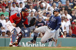 Tampa Bay Rays' Austin Meadows, right, slides safely home with an inside-the-park home run as Boston Red Sox catcher Christian Vazquez, left, waits for the throw during the ninth inning of a baseball game Monday, Sept. 6, 2021, at Fenway Park in Boston. (AP Photo/Winslow Townson)