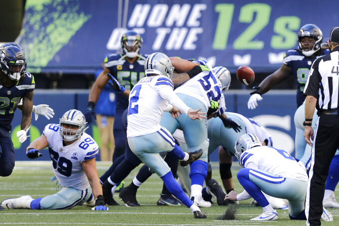 Dallas Cowboys kicker Greg Zuerlein (2) kicks a field goal during the second half of an NFL football game against the Seattle Seahawks, Sunday, Sept. 27, 2020, in Seattle. (AP Photo/John Froschauer)