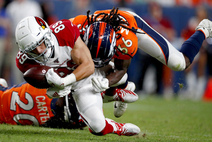 Denver Broncos defensive back Trey Marshall (36) forces Arizona Cardinals wide receiver Andy Isabella (89) to fumble during the second half of an NFL preseason football game, Thursday, Aug. 29, 2019, in Denver. (AP Photo/David Zalubowski)