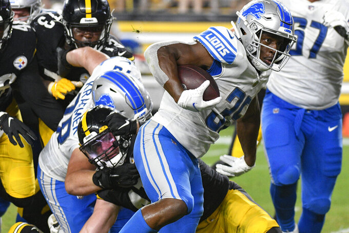 Detroit Lions running back Godwin Idwebuike (35) gets past Pittsburgh Steelers linebacker Robert Spillane on his way to a touchdown during the second half of an NFL preseason football game Saturday, Aug. 21, 2021, in Pittsburgh. (AP Photo/Don Wright)