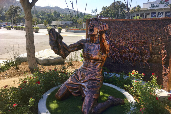 A statue capturing Brandi Chastain's iconic reaction to scoring the U.S. team's winning goal in the 1999 Women's World Cup, is shown after being unveiled outside the Rose Bowl in Pasadena, Calif., Wednesday, July 10, 2019. The 20th anniversary of the historic win coincided with celebrations in New York for this year's World Cup soccer championship team. (AP Photo/John Antczak)
