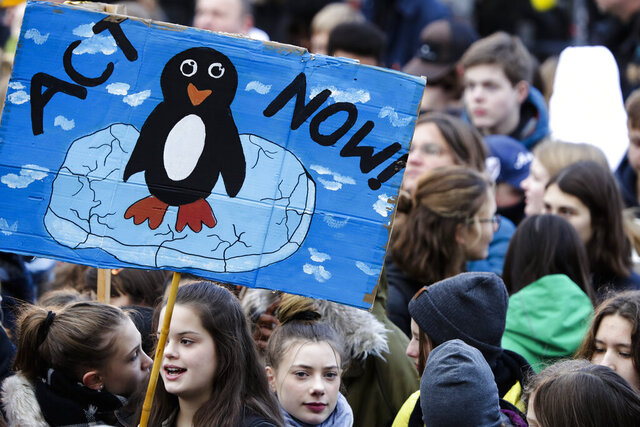 "FILE - In this Nov. 29, 2019, file photo, young people attend a protest of the Fridays For Future movement in Berlin, Germany. Ten cities around the world on Tuesday, Sept. 22, 2020, joined New York and London in committing to divest from fossil fuel companies as part of efforts to combat climate change. Berlin, Cape Town, Los Angeles, New Orleans, Oslo and others pledged to take ""all possible steps to divest city assets from fossil fuel companies and (increase) financial investments in climate solutions."" (AP Photo/Michael Sohn)"