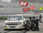 Chad Finley makes a pit stop during the NASCAR Truck Series auto race at Atlanta Motor Speedway, Saturday, Feb. 23, 2019, in Hampton, Ga. (AP Photo/John Amis)