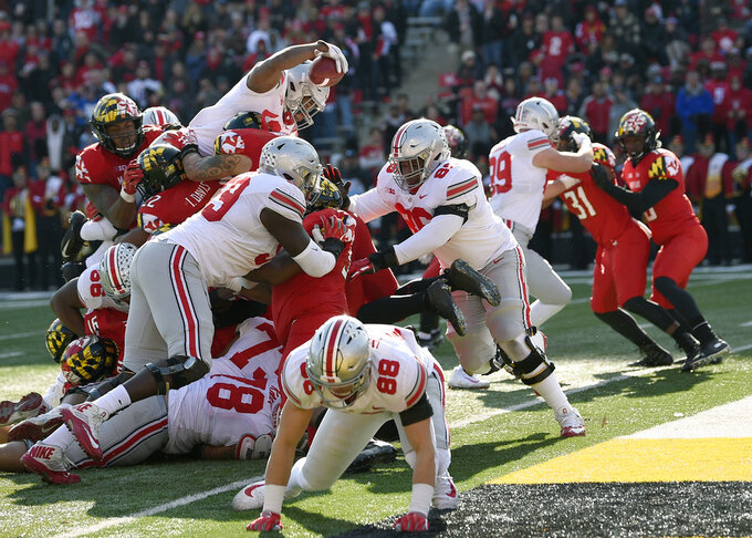 Ohio State running back J.K. Dobbins, top left, stretches for a touchdown during the first half of an NCAA football game against Maryland, Saturday, Nov. 17, 2018, in College Park, Md. (AP Photo/Nick Wass)