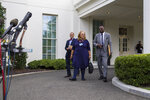 """FILE - In this July 29, 2019 file photo, Alveda King, a niece of Martin Luther King, Jr., center, arrives to speak with reporters, accompanied by Rev. Dean Nelson, left, and Bishop Harry Jackson, after meeting with President Donald Trump at the White House in Washington.    As the threat of impeachment looms, President Donald Trump is digging in and taking solace in the base that helped him get elected: conservative evangelical Christians who laud his commitment to enacting their agenda. Jackson, a  Maryland-based Pentecostal Bishop,  has prayed with Trump in the White House, and said that he plans to hold a large prayer gathering this year for """"healing in the nation.""""  (AP Photo/Alex Brandon, File)"""