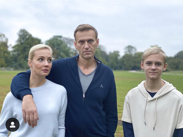 In this photo posted on the Instagram account of Russian opposition leader Alexei Navalny on Tuesday, Oct. 6, 2020, Navalny, center, poses for a photo with his wife Yulia and their son Zahar in an unknown location in Germany. (Alexei Navalny's Instagram Account via AP)