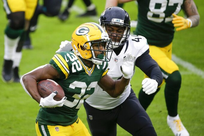 Green Bay Packers' Tyler Ervin runs during the first half of an NFL football game against the Jacksonville Jaguars Sunday, Nov. 15, 2020, in Green Bay, Wis. (AP Photo/Mike Roemer)